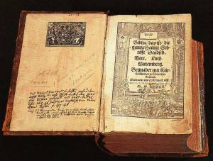 Luther Bible, 1534, photo taken by Torsten Schleese in Lutherhaus Wittenberg, 1999, Public Domain, via Wikimedia.